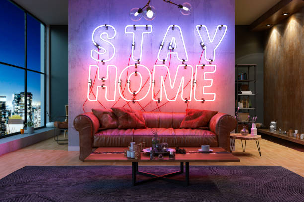 Neon Stay at Home Sign with Cpzy Interior Quarantine Concept stock photo