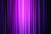 neon light background image containing multi coloured pinks and purples with a bright centre and dark areas for copy space. the lines of blur have been accentuated in post production with a subtle grain added for texture