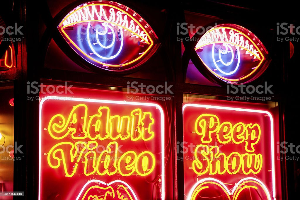 Neon strip club sign stock photo