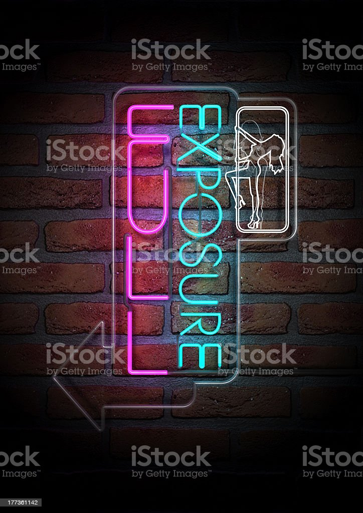 Neon Stripper Sign on A Face Brick Wall stock photo