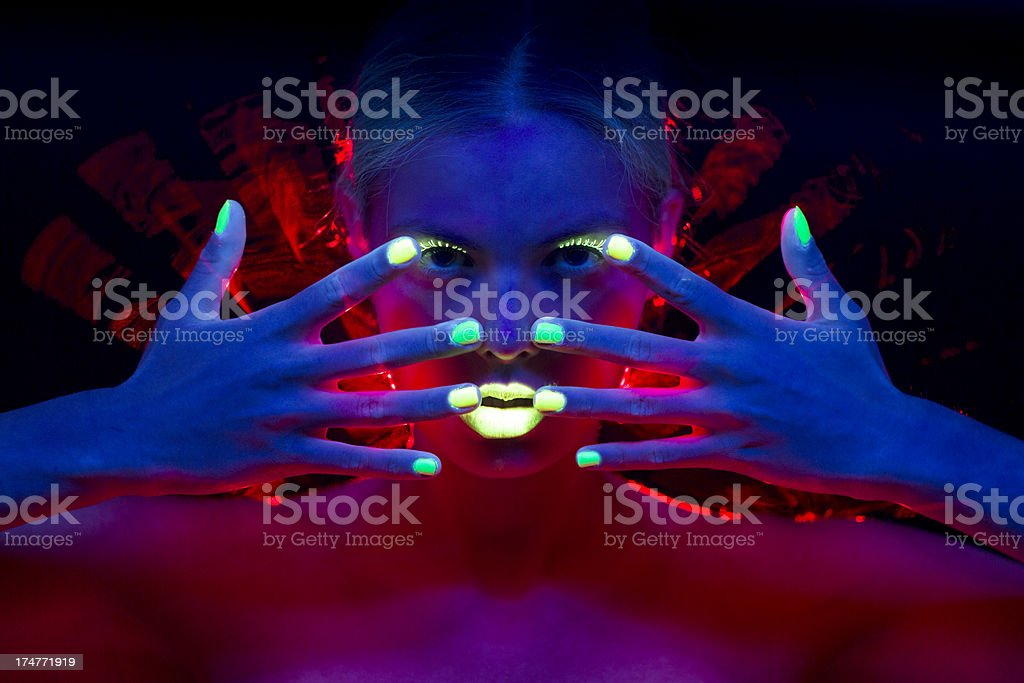 Neon Women Portrait with Lime Green Fingernails stock photo