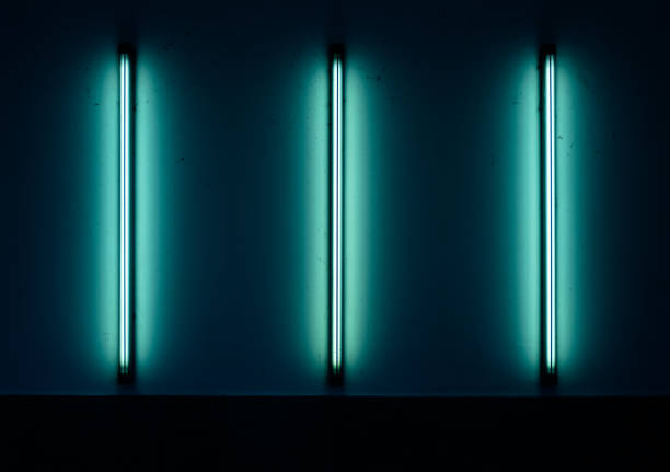 Neonlight Series: Three parallel Neonlights mounted on a wall stock photo