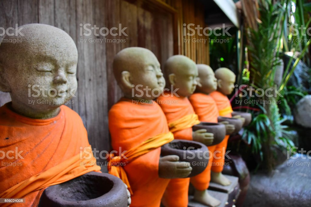 neophyte statue in act of receive food. stock photo