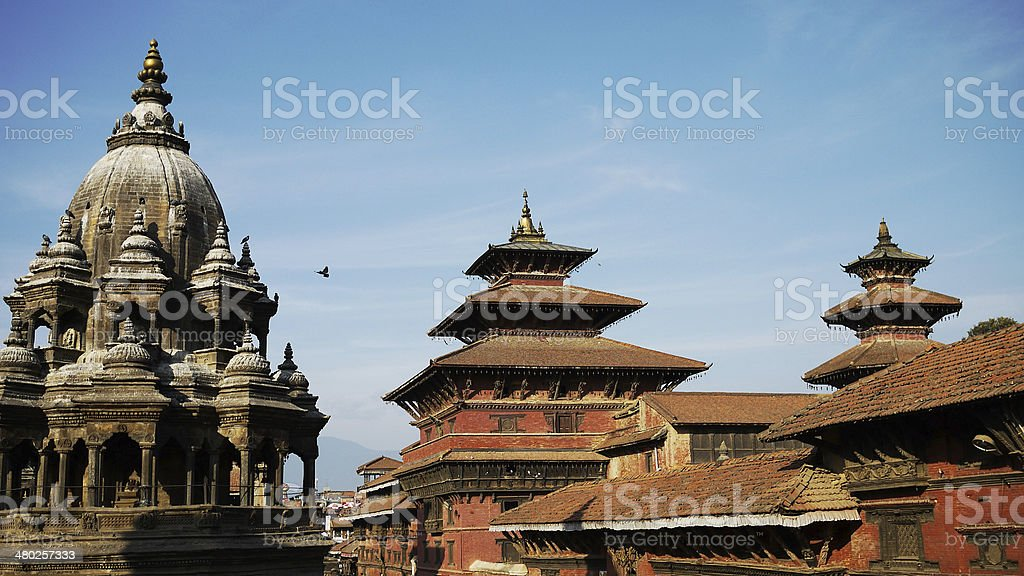 Nepal cityscape, ancient building with blue sky in patan stock photo