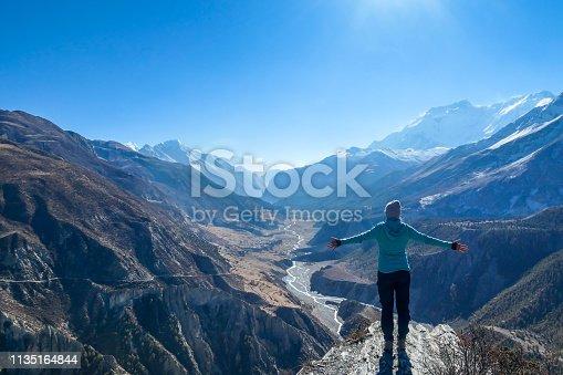 istock Nepal - Girl spreads her hands wide, Manang Valley 1135164844