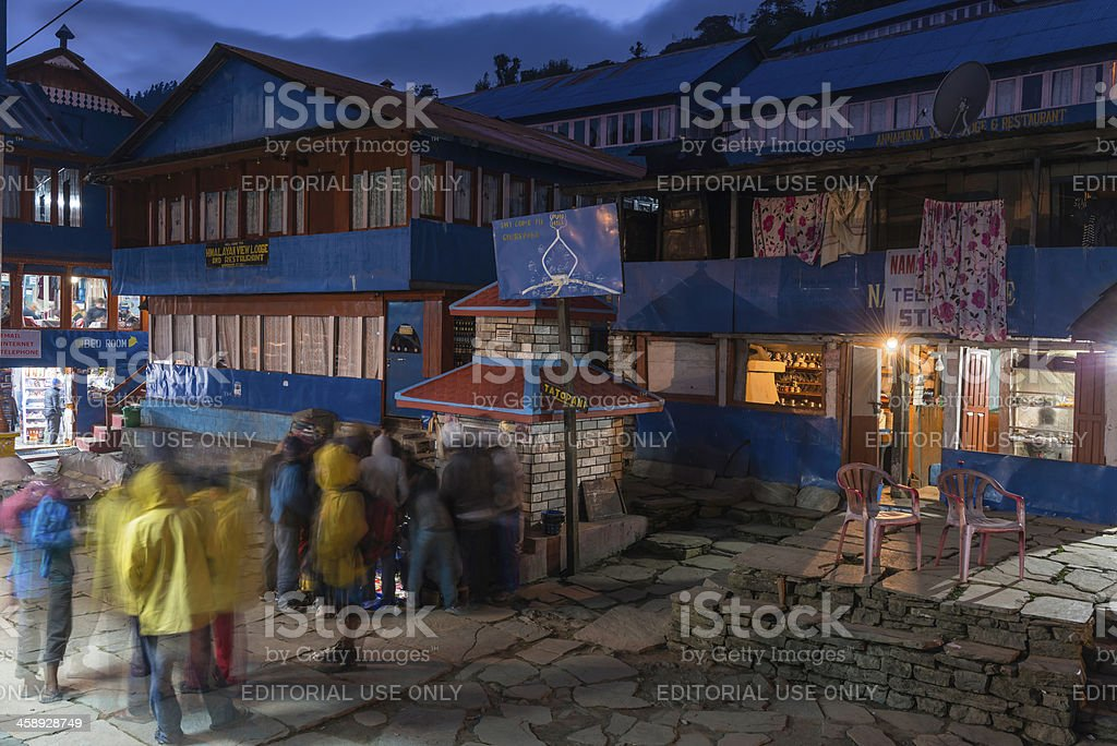 Nepal local porters gambling during Dasain festival Himalayas royalty-free stock photo