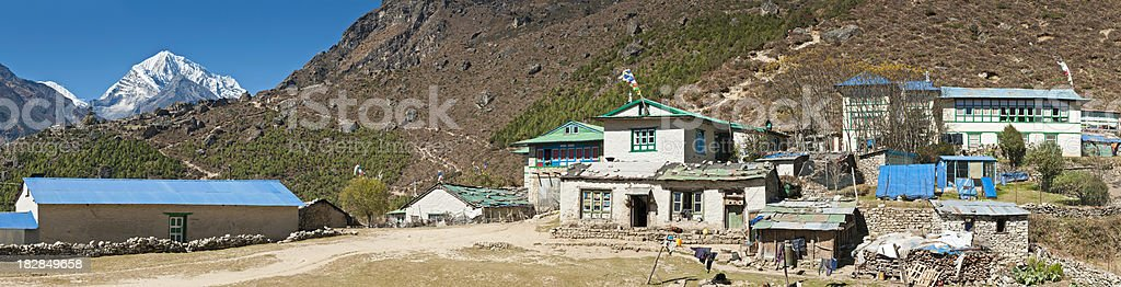 Nepal Sherpa mountain village teahouses lodges prayer flags Himalayas panorama royalty-free stock photo