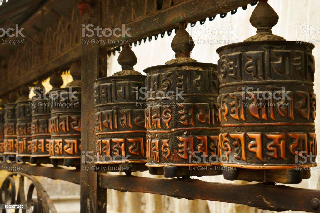nepalese buddhistic prayer wheels at stupa of Swayambhunath temple Kathmandu stock photo