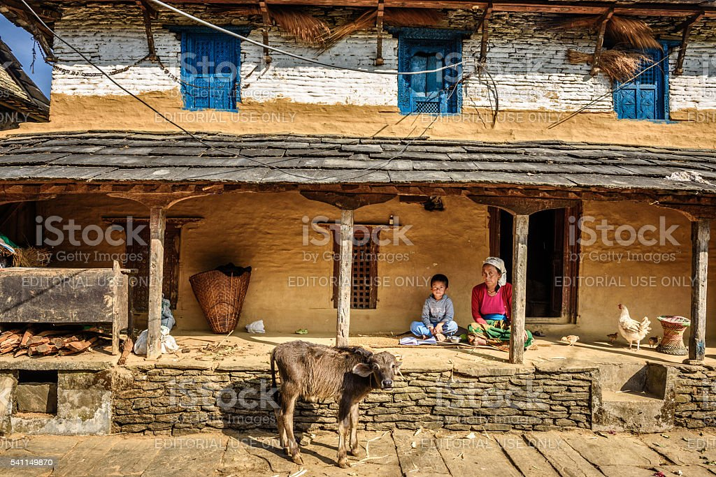 Nepalese farmer woman with her son stock photo