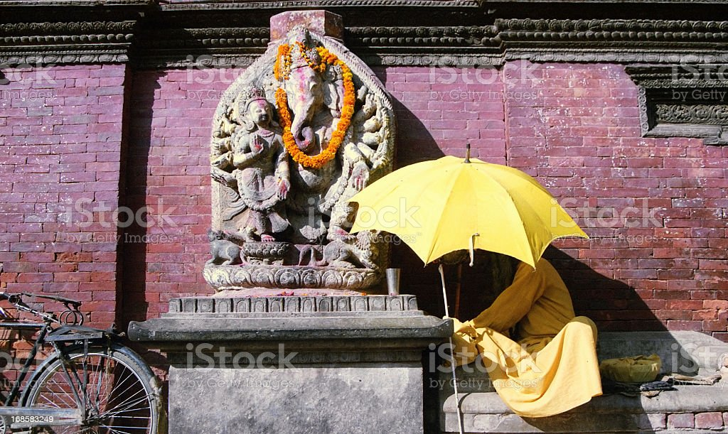 Nepalese hindu in front of a temple in Kathmandu, Nepal royalty-free stock photo
