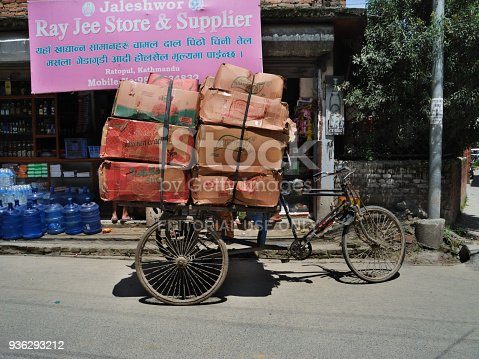 istock nepalese mode of transport cardboard boxes stack by tricycle Kathmandu 936293212