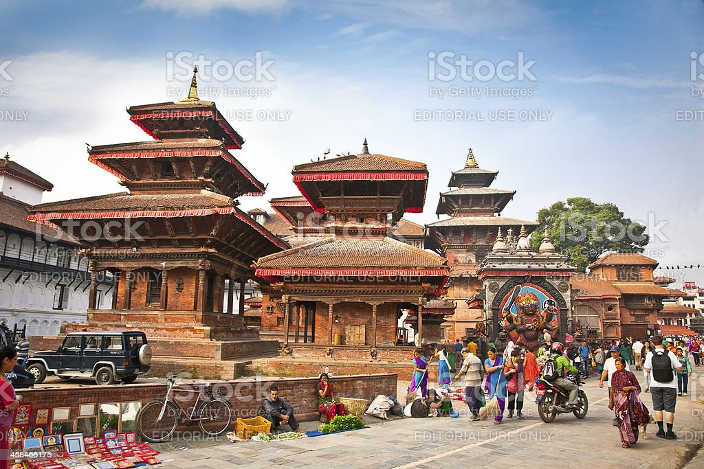 Nepalese people visit the famous Durbar square in Kathmadu. stock photo