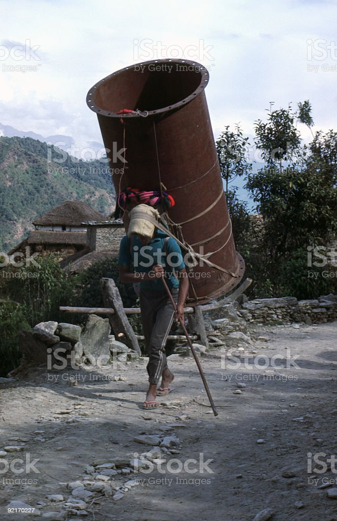 Nepalese Porter carrying improbable load royalty-free stock photo