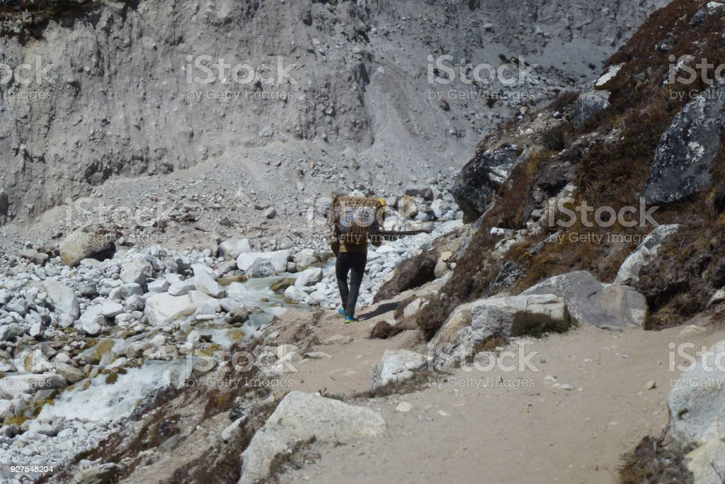 A nepalese porter in Dingboche, Everest Base Camp trek, Nepal stock photo