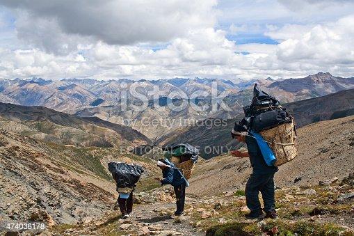 1067846662 istock photo Nepalese porters 474036178