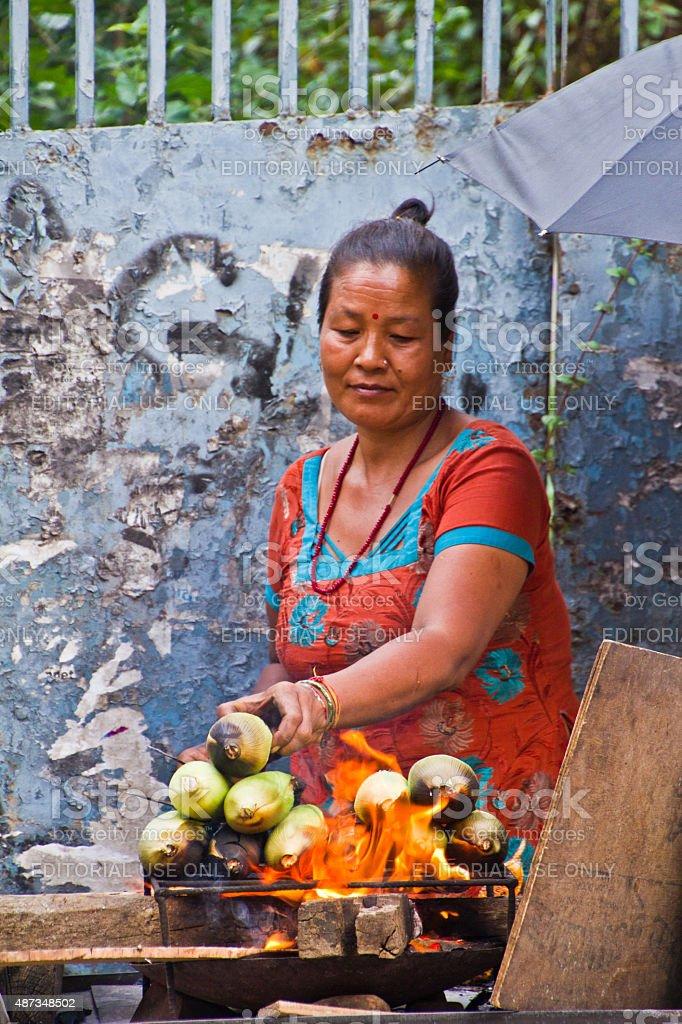 Nepalese woman selling corn, Kathmandu, Nepal stock photo