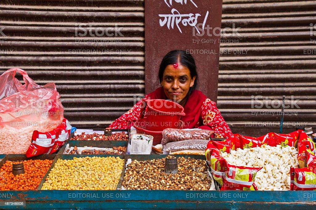 Nepalese woman selling popcorn, Kathmandu, Nepal stock photo
