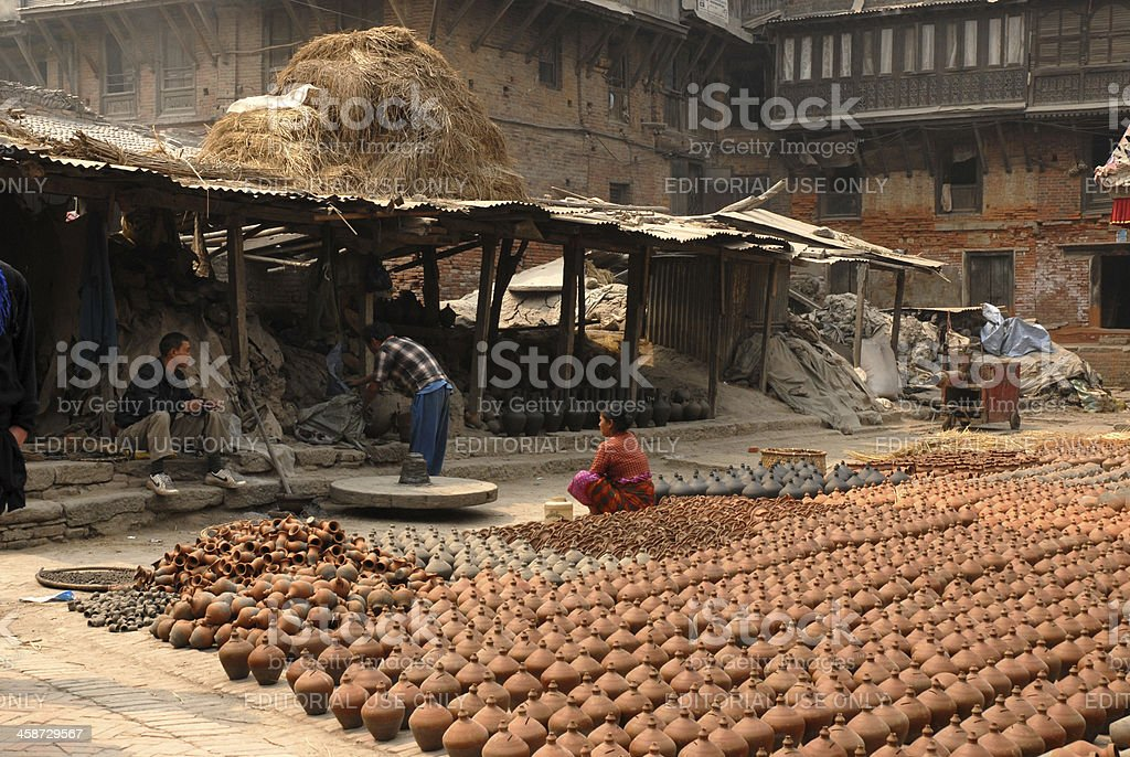 Nepalese woman working in outside royalty-free stock photo