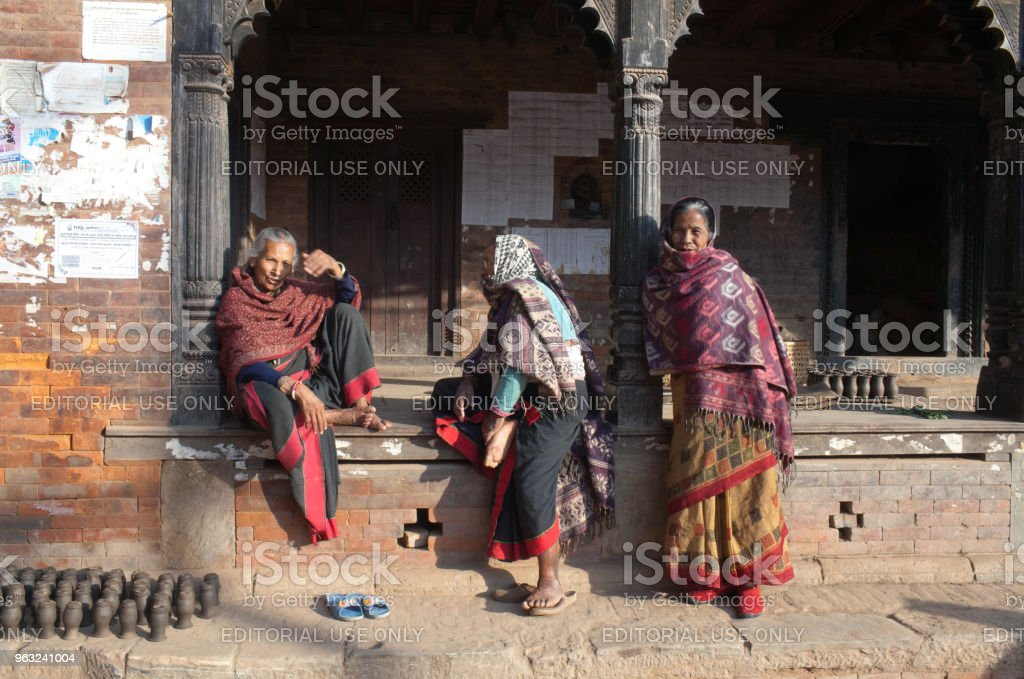 Nepalese women chat together at Durbar Square in Bhaktapur, Nepal stock photo