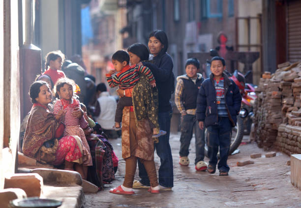 Nepalese women chat together in the street in Bhaktapur, Nepal stock photo