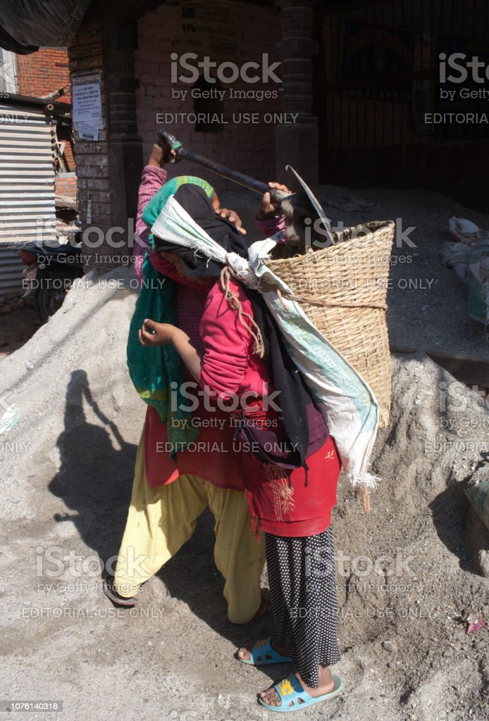 Nepalese women working hard in road-building after the earthquake damage stock photo