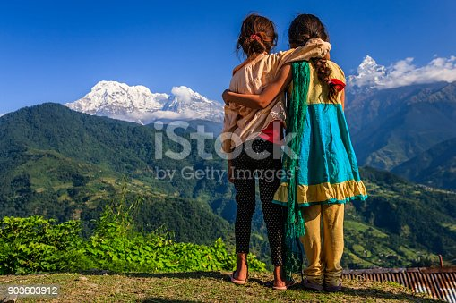 Nepali little girls, Annapurna Range on background. The Annapurna region is in western Nepal where some of the most popular treks (Annapurna Sanctuary Trek, Annapurna Circuit) are located. Peaks in the Annapurnas include 8,091m Annapurna I, Nilgiri and Machhapuchchhre. The Annapurna peaks are among the world's most dangerous mountains to climb.