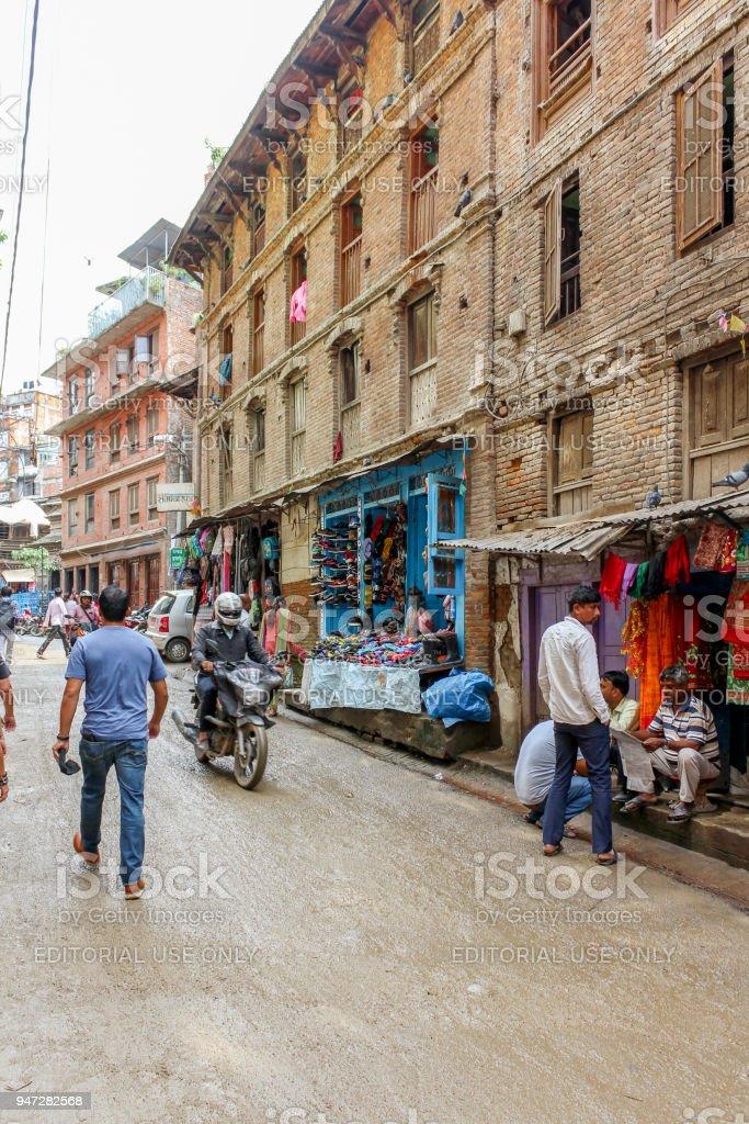 Nepali people riding motorcycle in Kathmandu streets, Nepal stock photo
