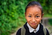 Nepali schoolgirl  in village in Annapurna Conservation Area.. The Annapurna region is in western Nepal where some of the most popular treks (Annapurna Sanctuary Trek, Annapurna Circuit) are located. Peaks in the Annapurnas include 8,091m Annapurna I, Nilgiri and Machhapuchchhre. The Annapurna peaks are among the world's most dangerous mountains to climb.