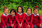 Nepali schoolgirls  in village in Annapurna Conservation Area.. The Annapurna region is in western Nepal where some of the most popular treks (Annapurna Sanctuary Trek, Annapurna Circuit) are located. Peaks in the Annapurnas include 8,091m Annapurna I, Nilgiri and Machhapuchchhre. The Annapurna peaks are among the world's most dangerous mountains to climb.