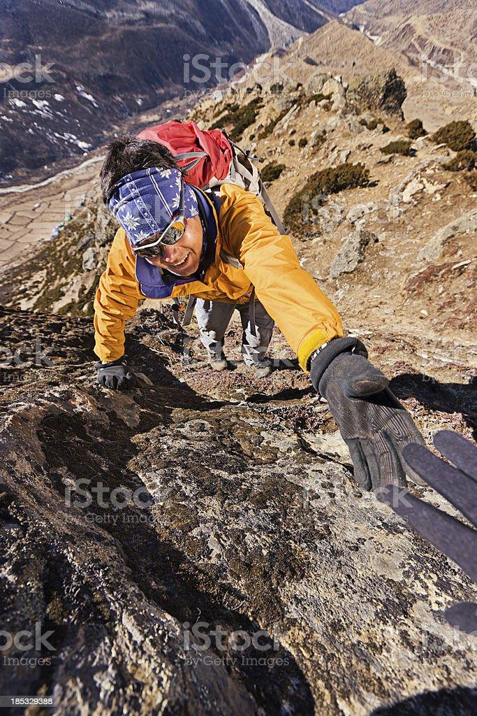 Nepali sherpa climbing in Himalayas royalty-free stock photo
