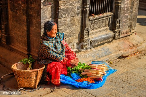 Nepali old woman selling vegetables on Durbar Square in Patan, Nepal.