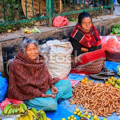 Nepali street  sellers selling vegetables on the streets of Kathmandu, Nepal.