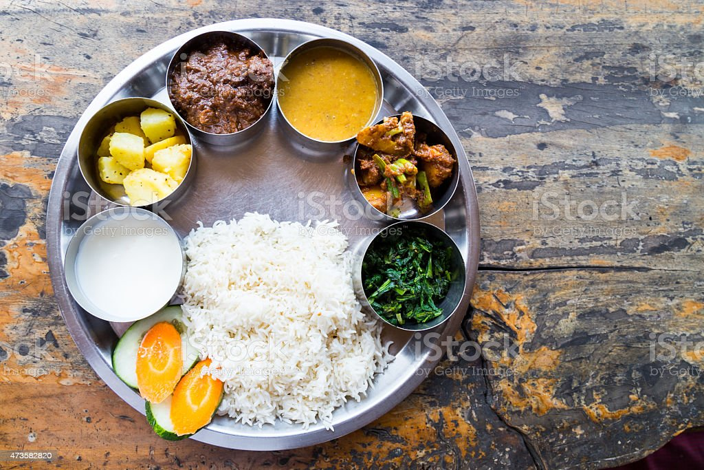 Nepali Thali meal set with mutton curry stock photo