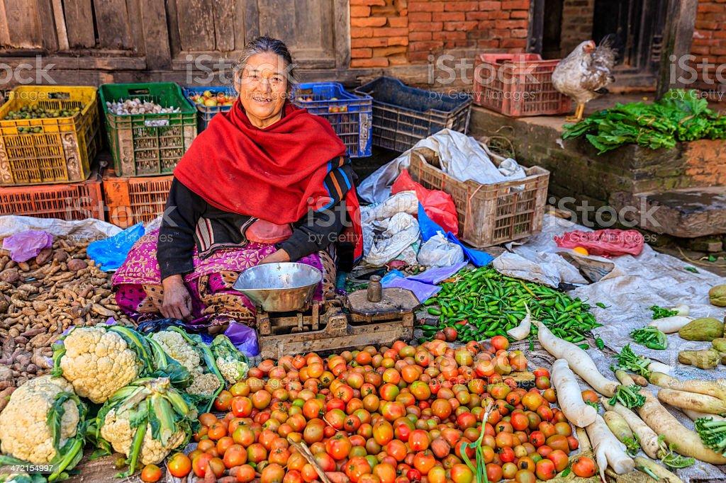 Nepali vegetables seller in Bhaktapur, near Durbar Square, Nepal royalty-free stock photo