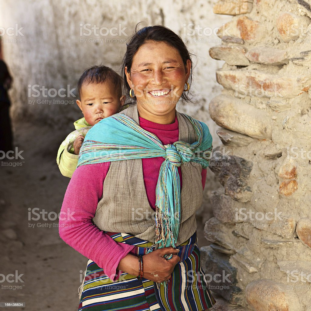 Nepali woman carrying her baby stock photo