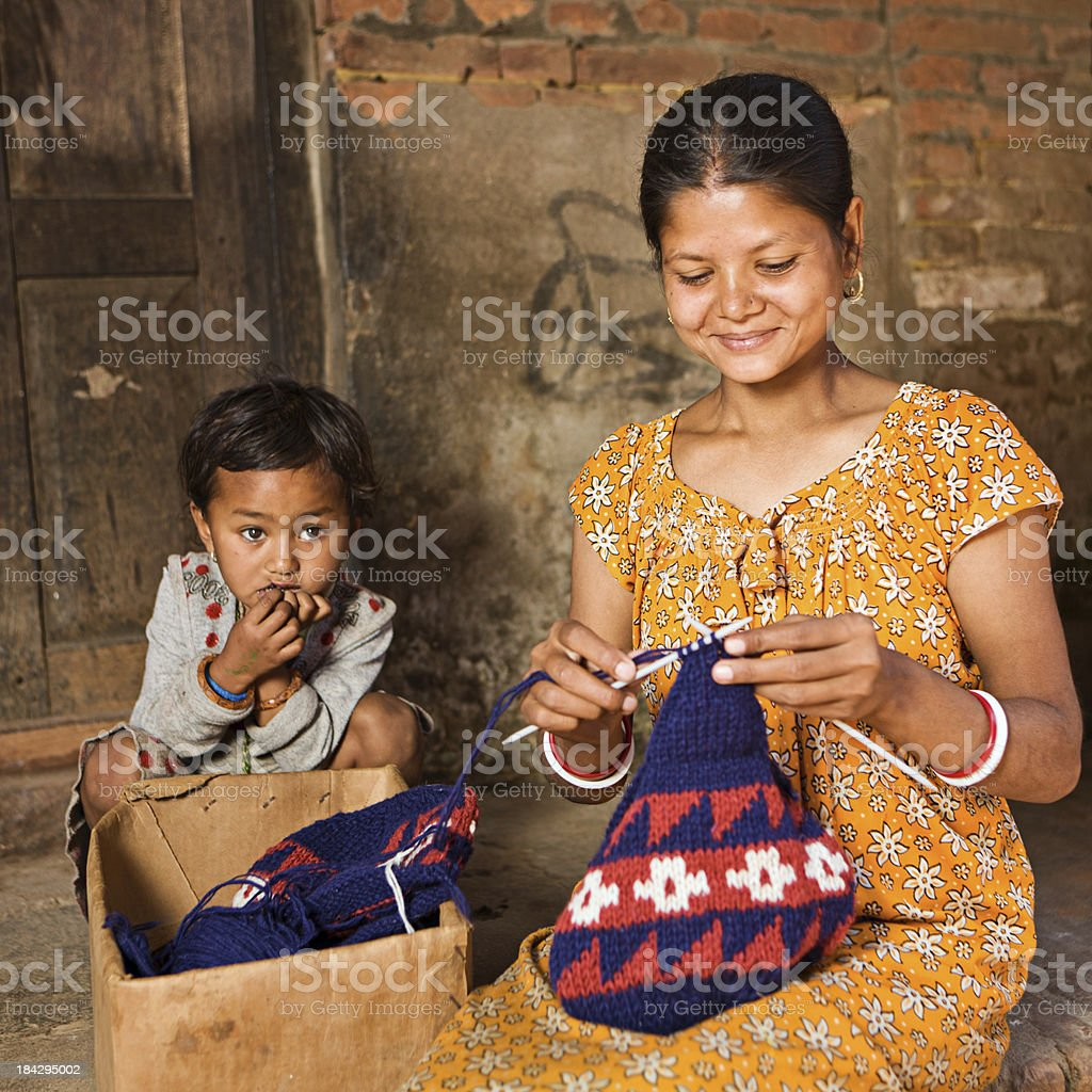 Nepali woman knitting wool hat in Bhaktapur royalty-free stock photo