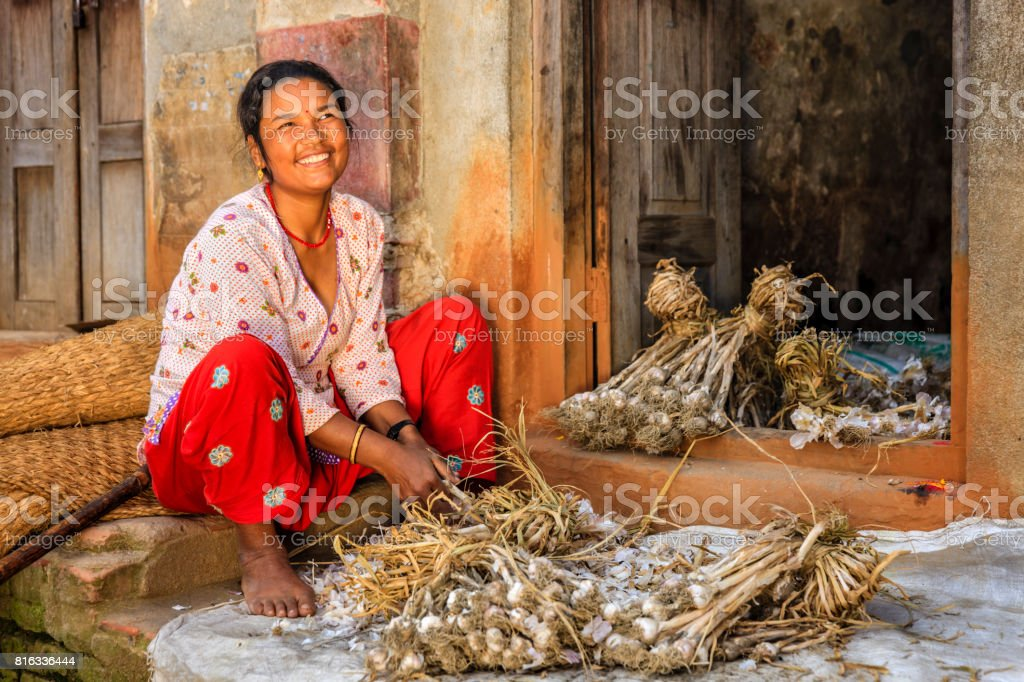 Nepali woman picking over a garlic in Bhaktapur, Nepal stock photo