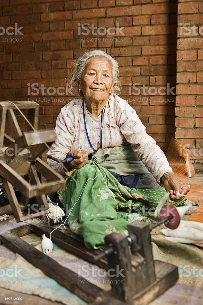 Nepali woman spinning the wool. Bhaktapur royalty-free stock photo