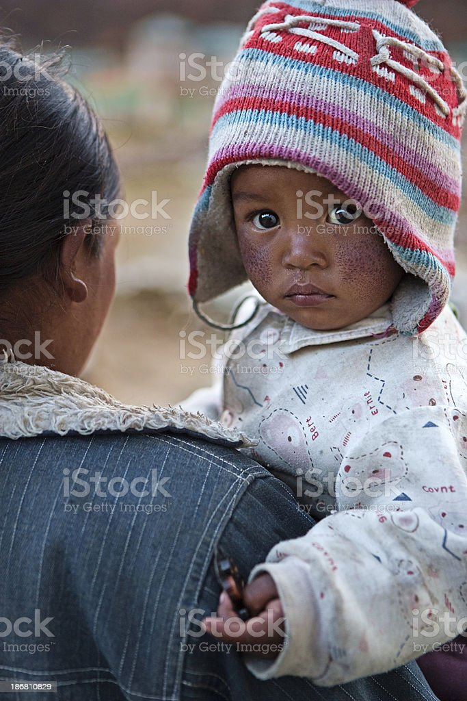 Nepali woman with her baby royalty-free stock photo