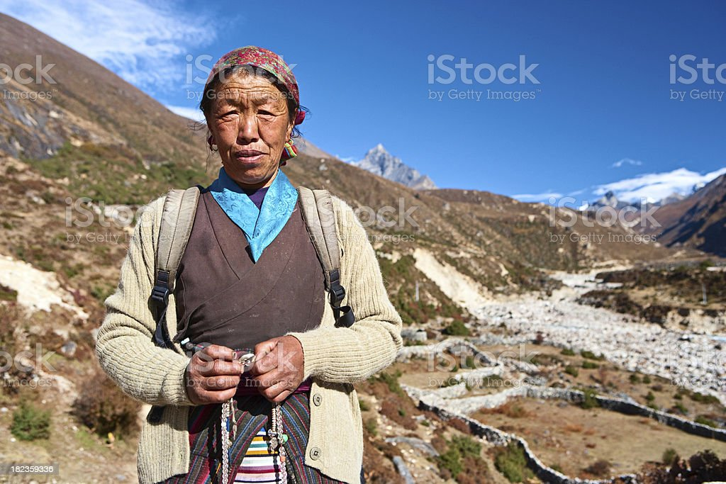 Nepali woman with rosary royalty-free stock photo