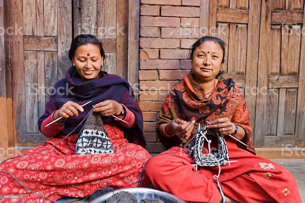 Nepali women  kniting wool hat. Bhaktapur. stock photo