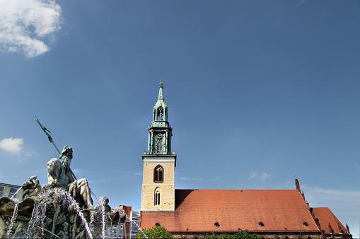 Neptune Fountain and St. Marien church