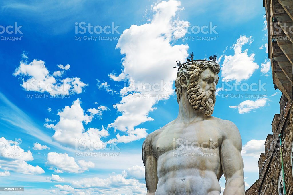 Neptune statue under a blue sky stock photo