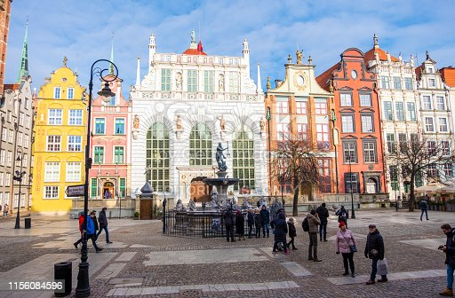 Gdansk, Poland - February 08, 2019: Neptune's Fountain in the centre of the Long Market Street next to Artus Court, Gdansk, Poland