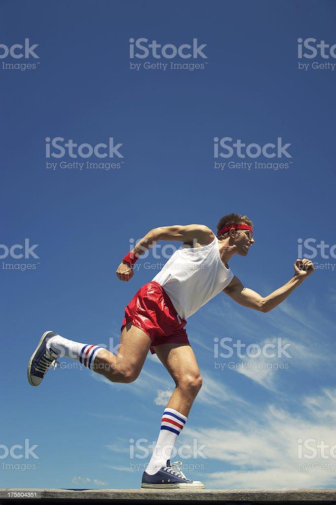 Nerd Athlete Red Shorts and Headband Runs Across Blue Sky royalty-free stock photo