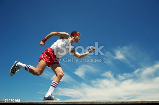Nerd athlete run across moody blue sky
