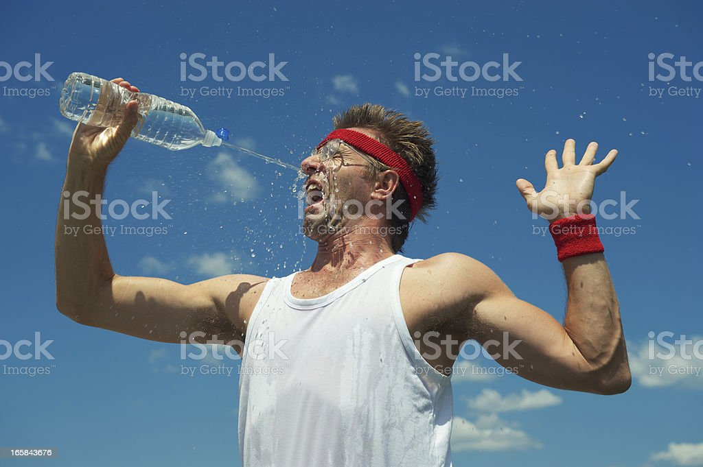Nerd Athlete Splashes His Face with Water stock photo