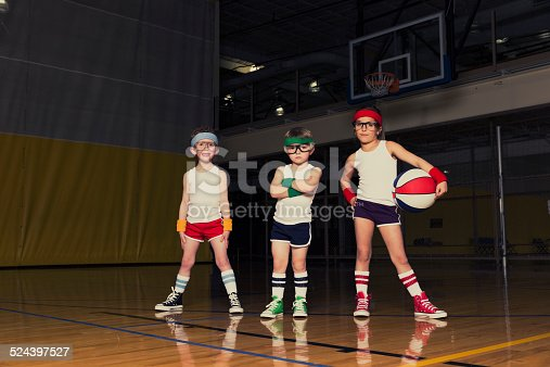 Retro-styled portrait of young children who are ready to school you in basketball.