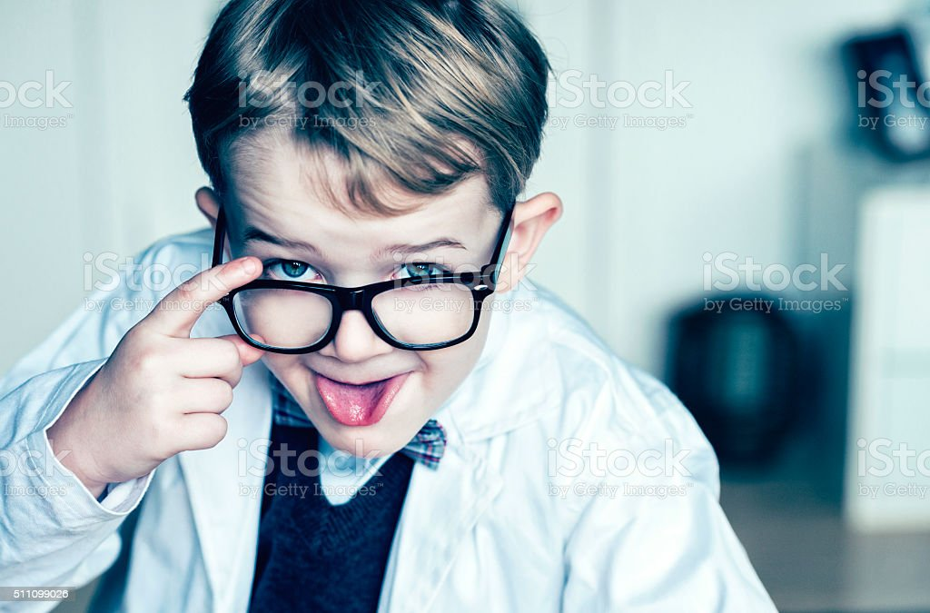 Nerd boy wears glasses and makes a funny face stock photo