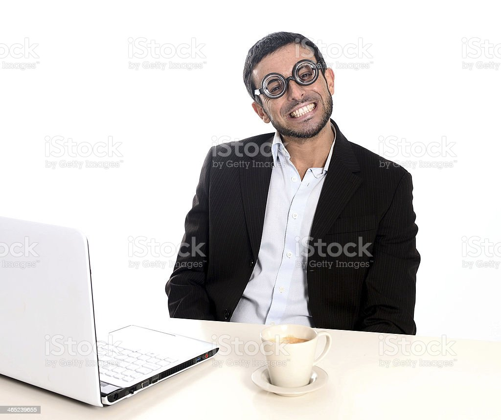 Nerd businessman in funny glasses working with computer royalty-free stock photo